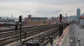 Elevated Subway Transit System Metro Train Passing Queens New York City Skyline Footage