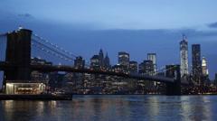 Illuminated Brooklyn Bridge, New York City One WTC World Trade Center Night Dusk - stock footage