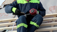 Construction roofer working on its equipment machine for roofing use Stock Footage