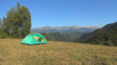 Tent on Meadow in Mountains for Tourists  People Camping, Landscape - stock footage
