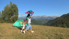 Mother and Child, Girl Running a Kite, Family have Fun on Meadow in Mountains Stock Footage