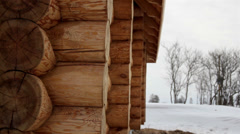 Close image of the log house tenon trees covered in snow Stock Footage
