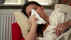 sick woman lying in her bed - stock footage