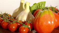 tomatoes, garlic and basil - stock footage