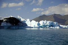 Icebergs lit by the sun Stock Photos