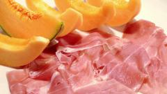 Dry cured ham and melon Stock Footage