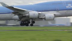 KLM Boeing 747 landing in slow motion Stock Footage