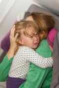 Sad unhappy crying little girl Stock Photos