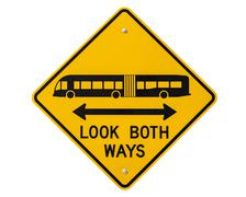 look both ways bus and tram warning sign isolated - stock photo