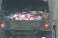 Stock Video Footage of POV thru windshield , Army HUMV carries ice bags on U.S. HWY-1 for distribution