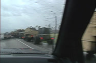 Stock Video Footage of U.S. Army relief convoy POV through windshield wipers, rain. Hurricane Andrew