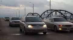 Metropolis. In big city heavy traffic. cars go on bridge in big city . Ulan Ude Stock Footage