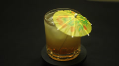 Amaretto Sour with Umbrella Stock Footage