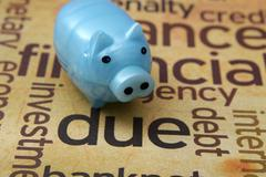 Stock Photo of piggy bank and debt concept
