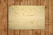 Stock Photo of old paper on wooden board