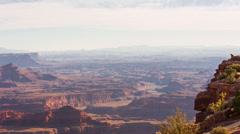 Dead Horse Point Pan zoom in on tourists Stock Footage
