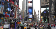 Stock Video Footage of Ultra HD 4K Shot Times Square Busy Tourist People Intersection Neon Commerce