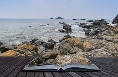 Stock Photo of rocky shore and brisons rock in distance at cape cornwall england