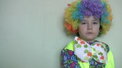 Little clown eating jellybean Stock Footage