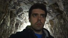 Lost in cave walking through tunnel Stock Footage