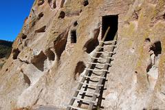 ladder to cave dwelling - stock photo