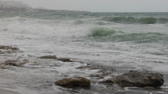 Stormy day at the sea. Waves crashing against the seashore. Stock Footage