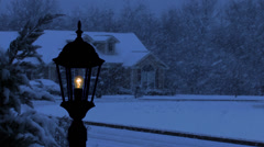 Pole light at night in snow storm in residential area. - stock footage