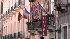 Hotel, Flags, Day, Building. Stock Footage