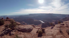 Aerial above Dead Horse Point pan across edge Stock Footage