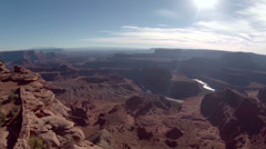 Aerial view of Dead Horse Point flying over cliffs Stock Footage
