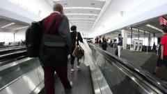 Moving sidewalk at busy airport - stock footage