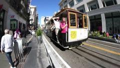 Cable car pulling up and stopping Stock Footage