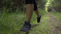SLOW MOTION: Close up female running through the woods Stock Footage