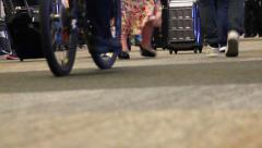 Airport security in busy terminal on bicycle Stock Footage