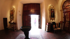 Exiting old Catholic mission into bright light - stock footage