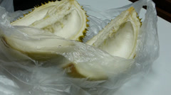Close-up of opening up a durian.(OPENING DURIAN--1) Stock Footage