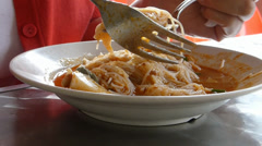 Eating a plate of mee siam.  (EATING MEESIAM--1A) Stock Footage