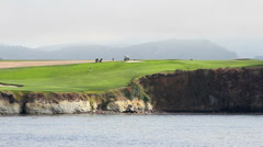 Pebble Beach fairway and green on waters edge Stock Footage