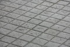 Pavement of granite in the city Stock Photos