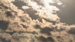 TIMELASPE_CLOUD_RAINBOW_INTO_SUN Stock Footage