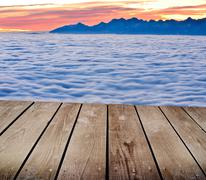 Landscape winter hill scene with fog and empty wooden deck table Stock Photos