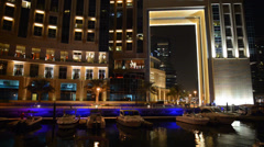 the night illumination of dubai marina. it is an artificial canal city, built - stock footage