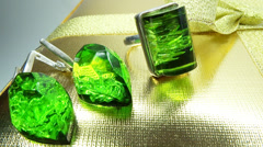 Jewelery emerald ring and earrings in gold box as present Stock Footage