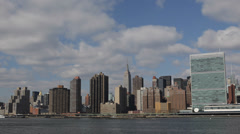 New York City Midtown Cityscape Empire State Building Company NYC Waterfront Day Stock Footage