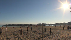 Beach volleyball game with sun Stock Footage