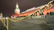 Stock Video Footage of Kremlin fence from M letters with Spasskaya tower on Red Square in Moscow