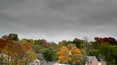 Cool cloud time lapse with autum / fall trees Stock Footage