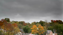 Autumn trees with cool ominous time lapsed clouds Stock Footage