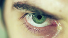 Closeup view of male green eye Stock Footage