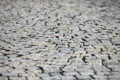 Small cobblestone sidewalk made of cubic stones structured background Stock Photos